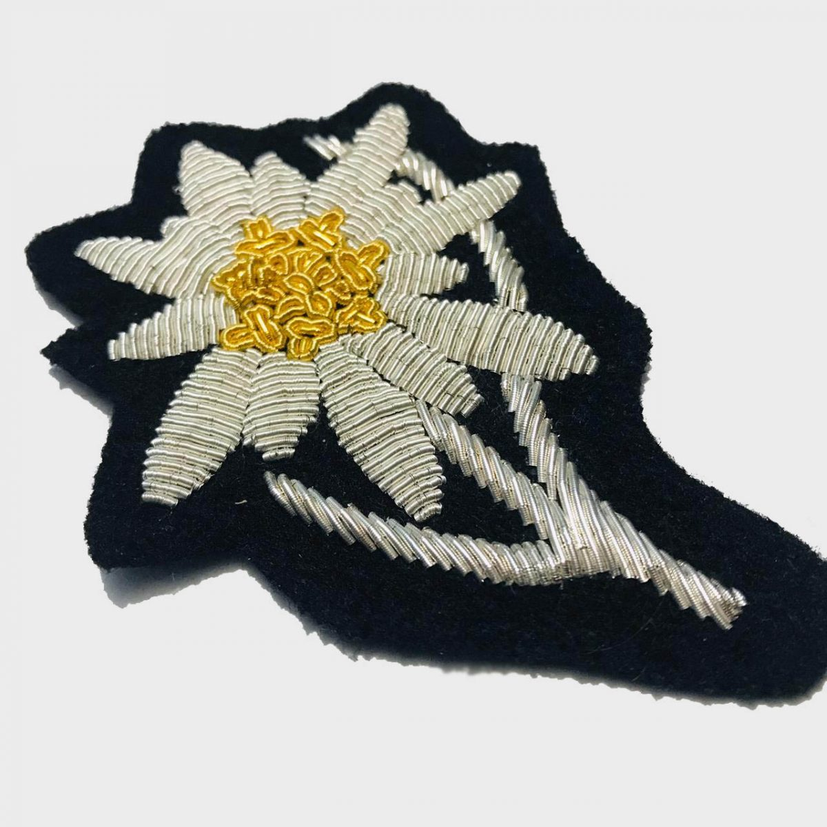 Edelweiss Flower Bullion Embroidered Badge , Sew-on Applique Patch - Edelweiss Embroidered PatchSize # 3 inchesSew-on backingSilver bullion wires embroidered on felt  4