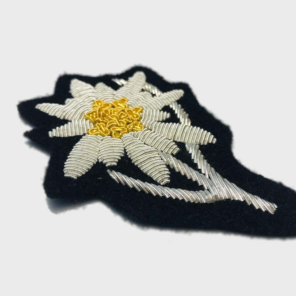 Edelweiss Flower Bullion Embroidered Badge , Sew-on Applique Patch - Edelweiss Embroidered PatchSize # 3 inchesSew-on backingSilver bullion wires embroidered on felt  3