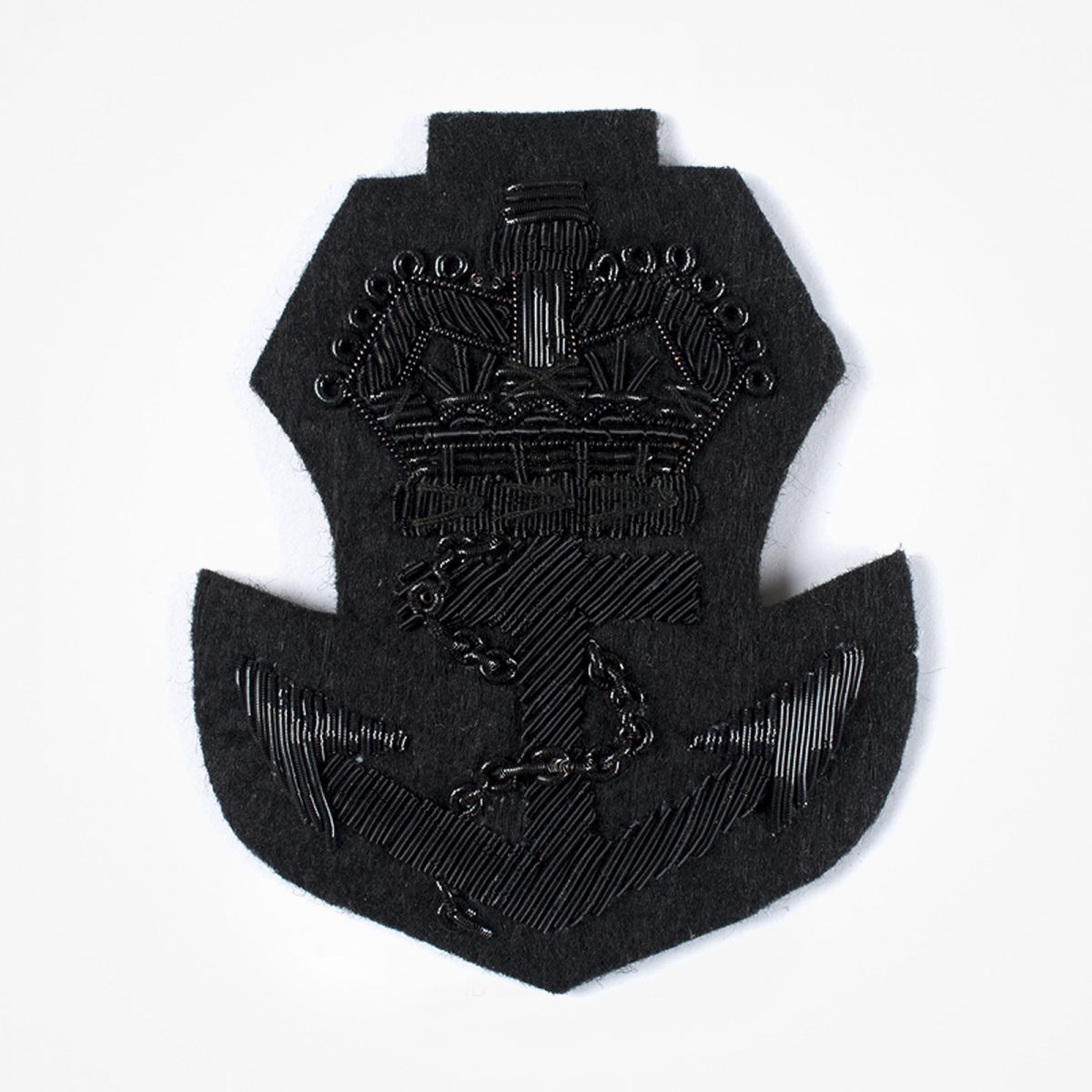 Black Anchor with Crown - Black Anchor Embroidered patch Fashionable 3D embroidered look Made by skilled artisans Bullion wire and silk thread hand Stitched on Black colour Felt Available in gold and silver colors Size = 75mm height x 63mm width sew-on backing: Perfect for caps, sports jacket, leather jackets, blazer coat, Blazer Pocket, shirts uniforms, Accessories and many More Pin backing: easy to removable 3